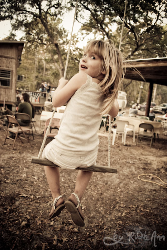 little girls on swing